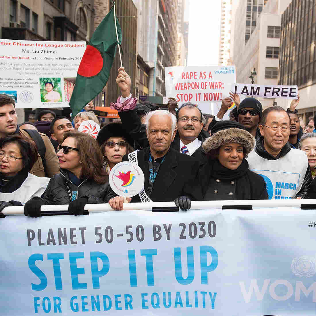 U.N. Secretary-General Ban Ki-Moon (in white-and-blue vest) joins other leaders at the 2015 International Women's Day March at Dag Hammarskjold Plaza on March 8 in New York City.