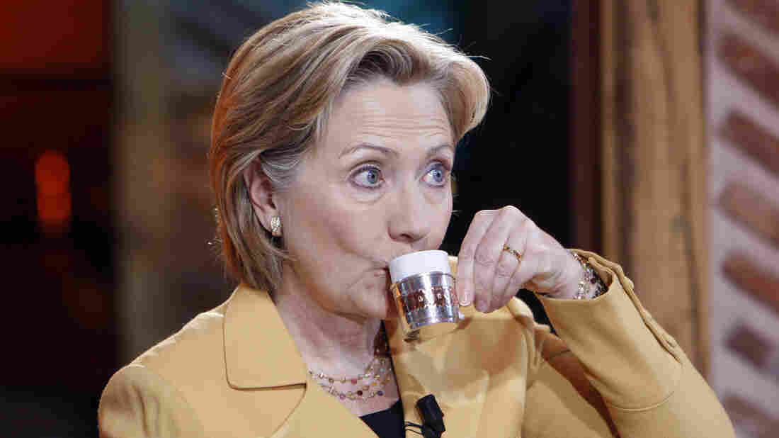 """Then-U.S. Secretary of State Hillary Clinton sips tea on Turkish television program """"Lets come to be with us"""" at the US Embassy in Ankara March 7, 2009."""