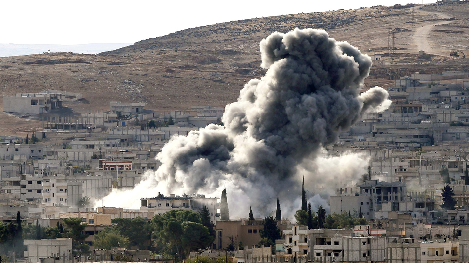 Heavy smoke rises following an airstrike by the U.S.-led coalition aircraft in Kobani, Syria, during fighting between Syrian Kurds and the militants of the self-declared Islamic State in October 2014.