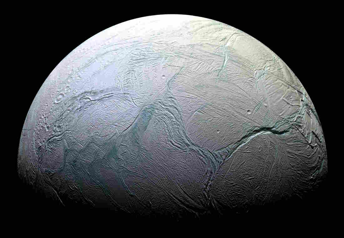 New research suggests that Saturn's tiny moon Enceladus has warm oceans hiding beneath its icy crust.