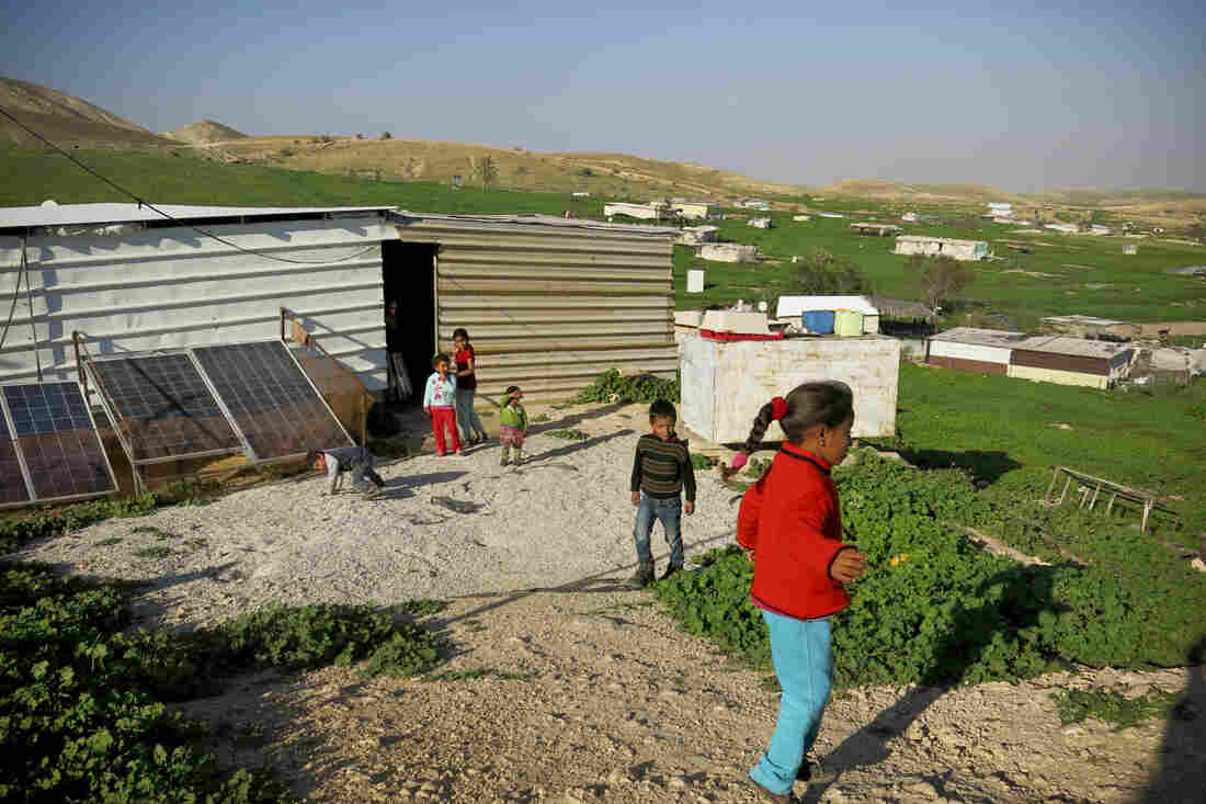 Children play at a Bedouin camp in the Jordan Valley, West Bank. The camp is located in Area C, the 60 percent of the West Bank under exclusive Israeli control.