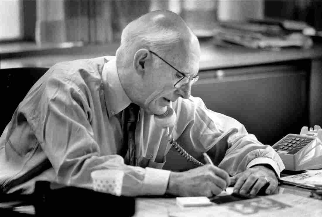 Claude Sitton, then-editor of the News & Observer, works in his office at the newspaper in Raleigh, N.C., in 1990. Sitton, who was a leader among reporters covering the civil rights movement in the South in the 1950s and '60s and later won a Pulitzer Prize for distinguished commentary, died Tuesday, March 10, 2015. He was 89.