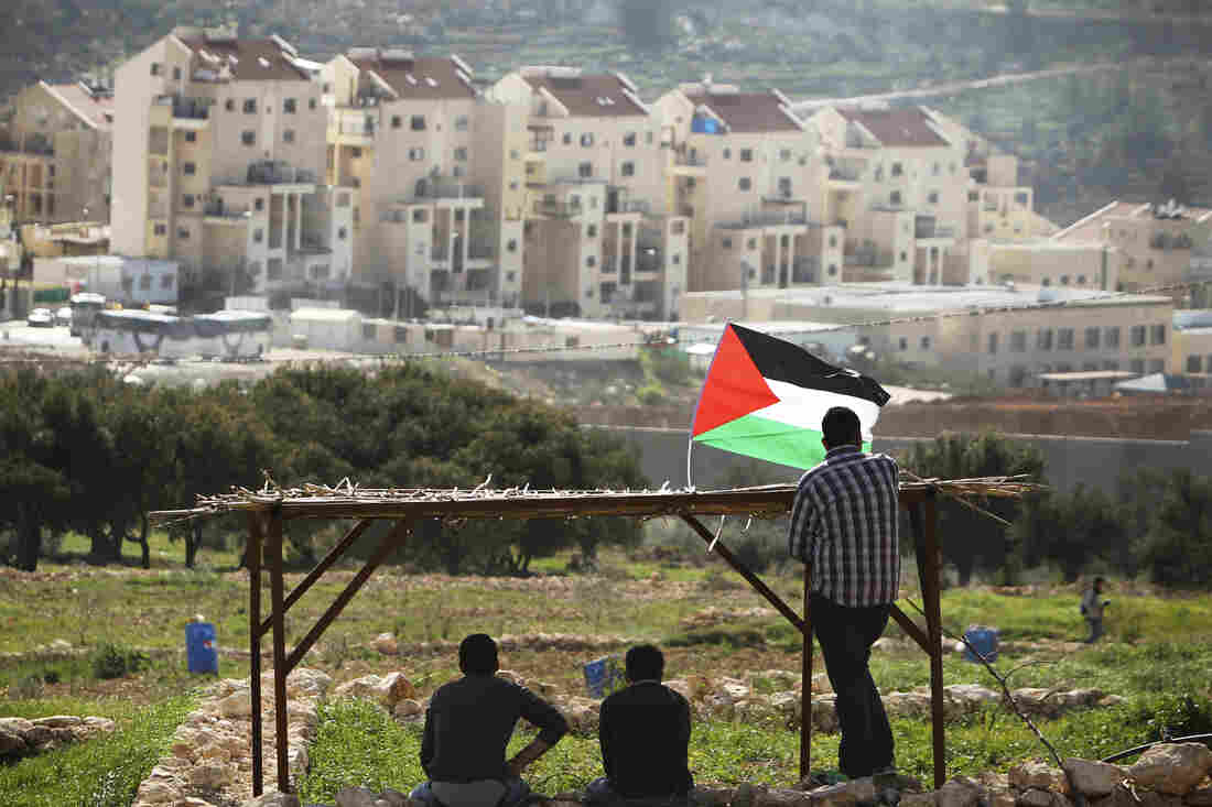 Palestinian protesters look out at the Israeli settlement of Modiin Illit during a demonstration last month in the West Bank town of Bilin, near Ramallah. Both candidates are concerned about their country's relations with the Palestinians.