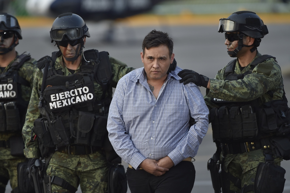 The alleged leader of the Zetas drug cartel, Omar Trevino Morales, is taken under custody to be presented to the press at the Attorney General Office's hangar at the airport in Mexico City, on March 4. Mexican authorities captured Trevino Wednesday, dealing a blow to the feared gang and giving the embattled government a second major arrest in a week. (Omar Torres/AFP/Getty Images)