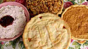 Four pies on a floral tablecloth
