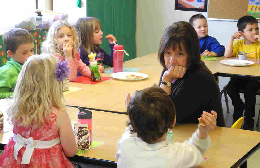 Idaho preschool teacher Mary Allen listens to one of her students during their afternoon snack time. The state doesn't have public preschool, so programs are paid for through a hodgepodge of funding sources.