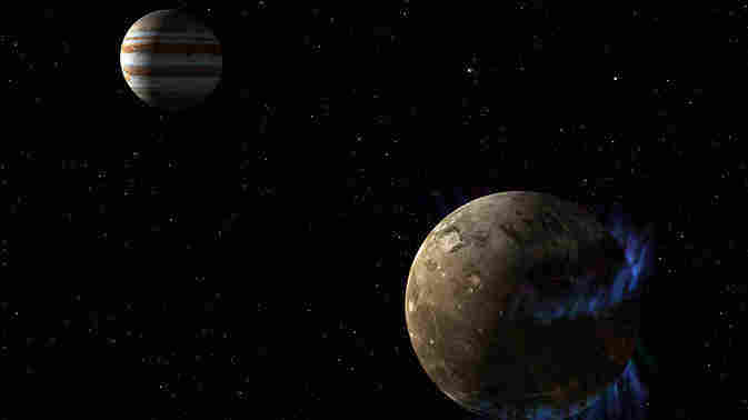 The moon Ganymede (right) orbits the giant planet Jupiter in this artist's rendering. Scientists say a saline ocean lurks under the moon's icy crust.