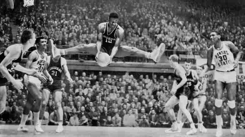Oscar Robertson, Cincinnati's All-American Star, is seen mid-air after a rebound catch during the NCAA regional elimination game in Manhattan, Kan., in March 1959.
