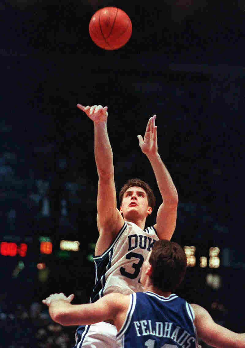 In this March 28, 1992, file photo, Duke's Christian Laettner takes the winning shot in overtime over Kentucky's Deron Feldhaus.