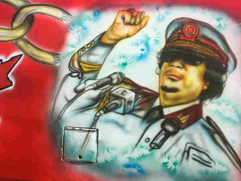 Yes, that is the late Libyan leader Moammar Ghadafi. On a bus. In Nairobi.
