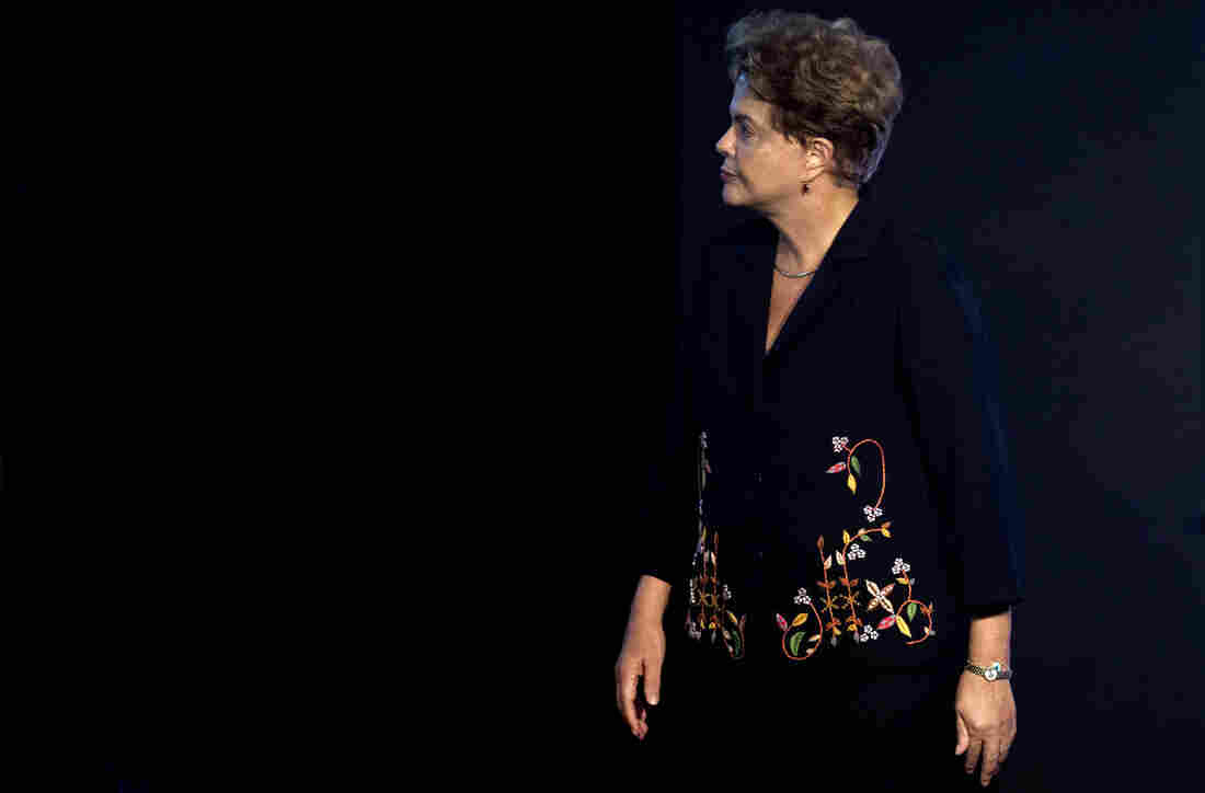 Embattled Brazilian President Dilma Rousseff (shown here at the 21st International Construction Salon in Sao Paulo, Brazil, on Tuesday) was elected four months ago. Her administration has been hit hard by economic problems and a massive corruption scandal at the state oil company, Petrobras.