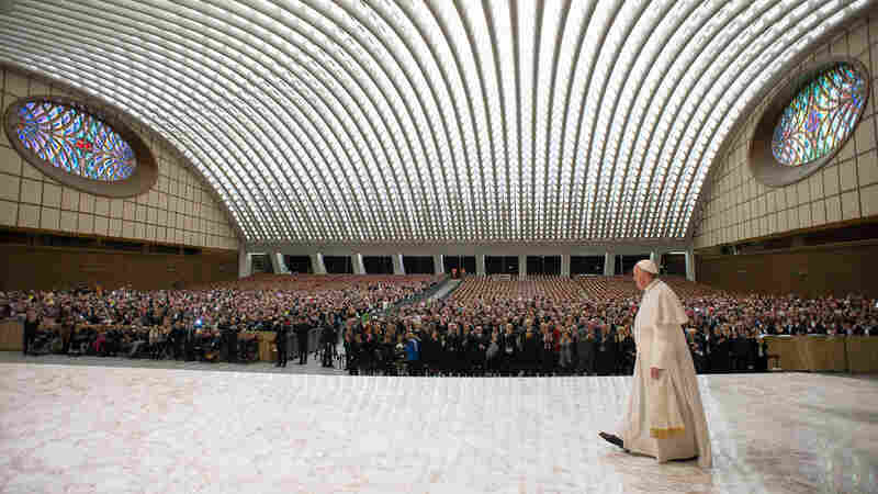Pope Francis arrives for a special audience with the members of the UCIIM Catholic union of Italian secondary school teachers, in the Pope Paul VI hall, at the Vatican on Saturday.