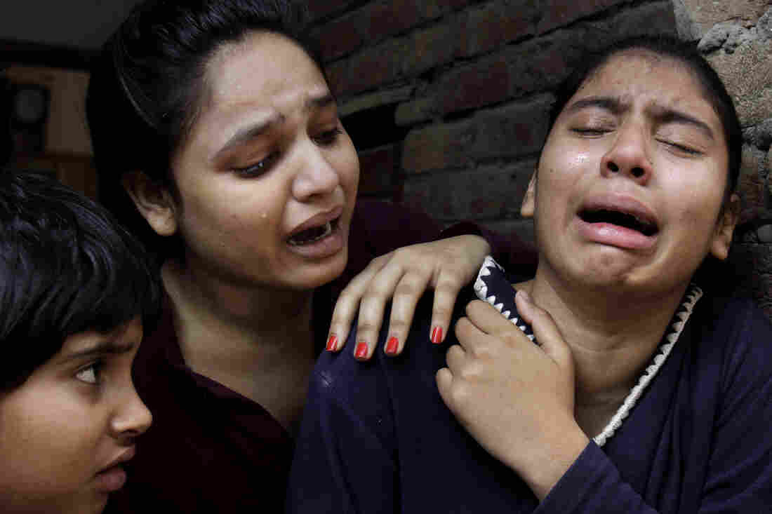 Girls mourn a family member killed in a suicide bombing attack near two churches in Lahore, Pakistan, on Sunday.