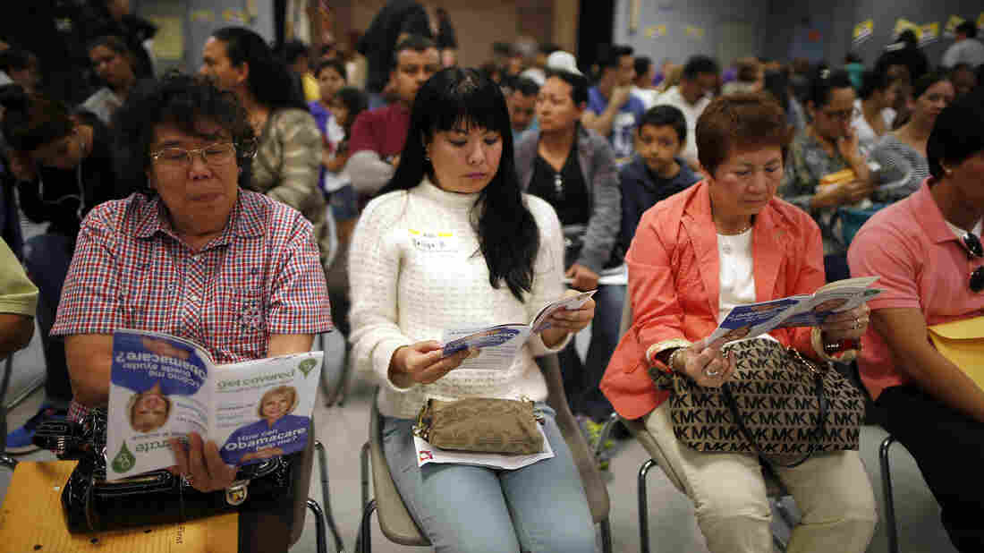 People wait to sign up for health insurance in Cudahy, Calif., in late March 2014.