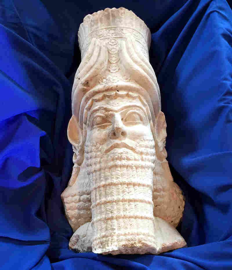 The head of a limestone statue representing Assyrian King Sargon II.