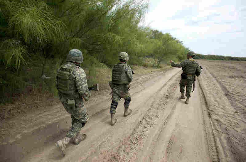Soldiers patrol the banks of the Rio Grande on the outskirts of Tamaulipas state, Mexico. The rampant drug cartel-related violence is another deterrent to wide-scale foreign investment.