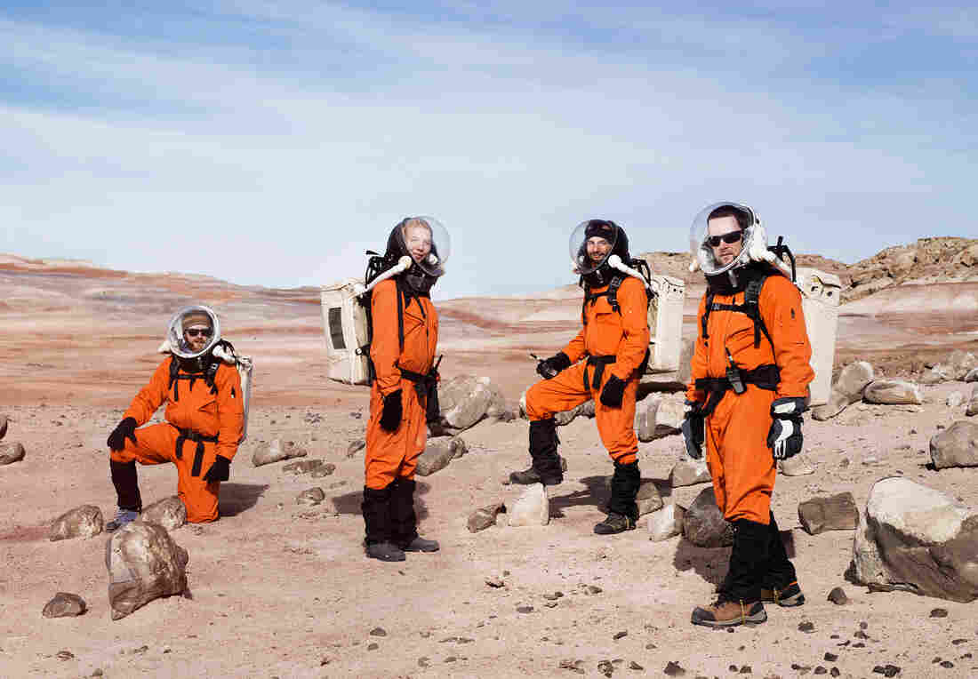 Mars, anyone? Six researchers from the Mars Society sport their best space duds during this 2014 simulation of the conditions that explorers of the Red Planet might face. (From left) Ian Silversides, Anastasiya Stepanova, Alexandre Mangeot and Claude-Michel Laroche.