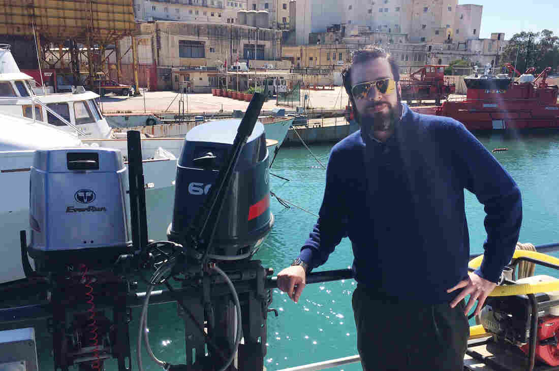 Christopher Catrambone stands in front of the Phoenix, the ship that MOAS uses for sea rescues.
