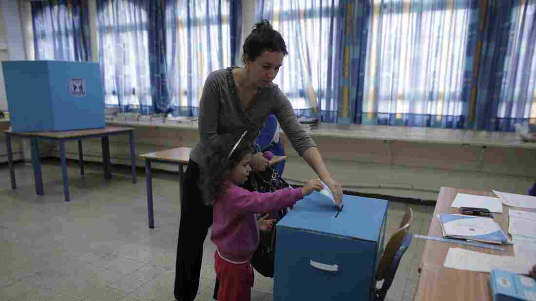 An Israeli woman votes with her daughter at a polling station in the coastal city of Haifa on Tuesday. Israel faces an unpredictable election to determine whether Prime Minister Benjamin Netanyahu will remain in power.