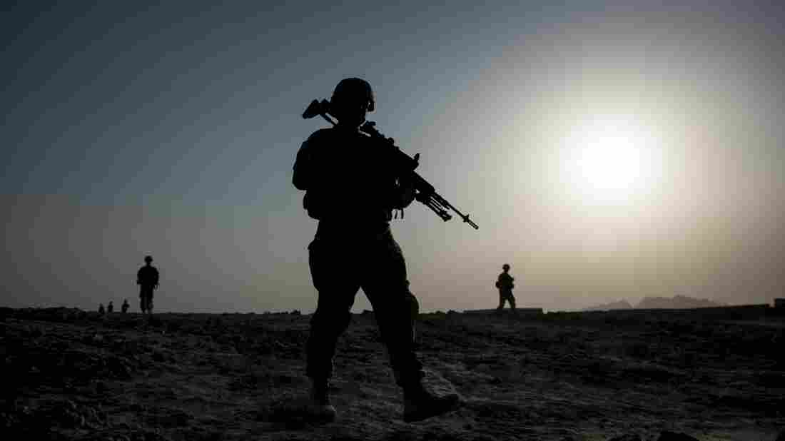 U.S. soldiers patrol near Kandahar airfield in Afghanistan on June 2014. The House Republicans' budget proposal requests less money for defense than the Obama administration's plan, but tries to close some of the gap by adding billions to the Overseas Contingency Operations fund, which has been helping pay for the wars in Afghanistan and Iraq.
