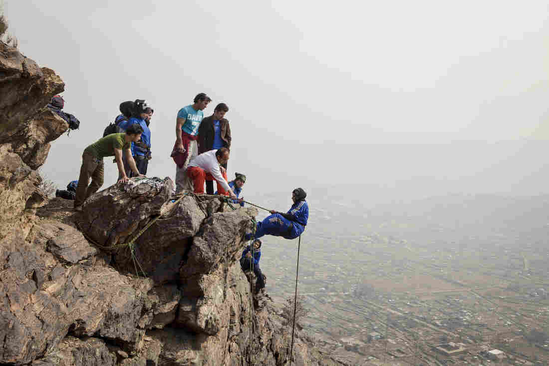 Eighteen-year-old Zahra Karimi Nooristani dangles precariously off a rock face high above Kabul.