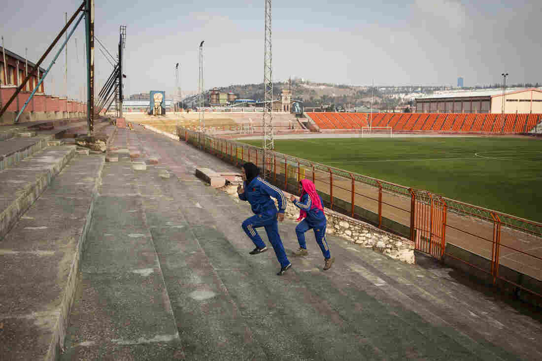 The young women train in earnest at Ghazi Stadium, where they sprint up the bleachers and rappel down 23-foot-high walls.