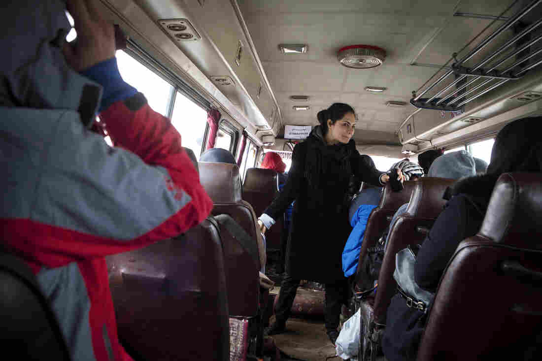 Nargis Azaryun briefs the young women in the bus heading to a weekly practice ascent on the outskirts of Kabul.