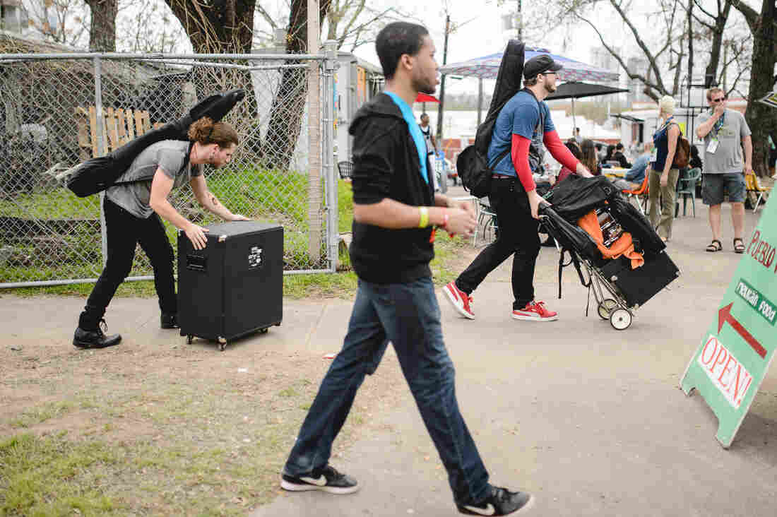 Day One DIY: Musicians load equipment in East Austin.