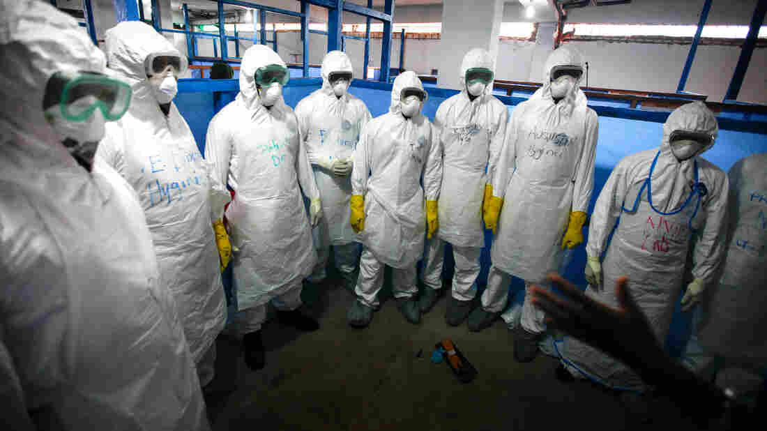 Health workers suit up for Ebola duty in Monrovia, Liberia.