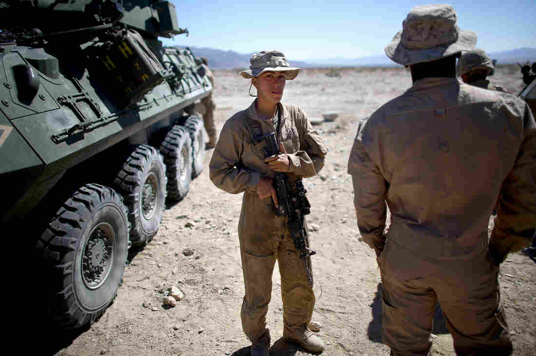 Lance Cpl. Brittany Dunklee talks with her fellow Marines.