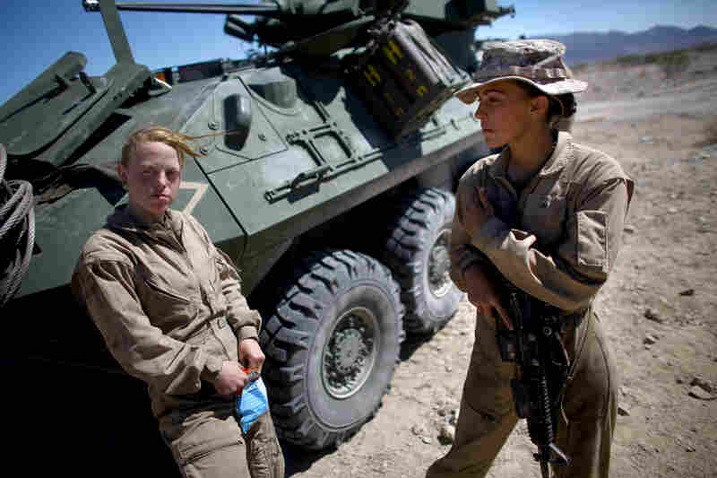 Lance Cpl. Brittany Holloway (left) talks with Brittany Dunklee next to their LAV.
