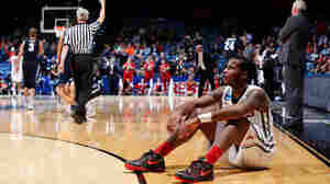 Jarvis Summers of the Mississippi Rebels sits on the court in the closing seconds of his team's 17-point comeback win against Brigham Young during the first round of the 2015 NCAA Men's Basketball Tournament.