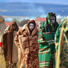 These teens from the Xhosa tribe wear traditional garb and paint after their coming-of-age circumcision ceremony near Qunu, South Africa.