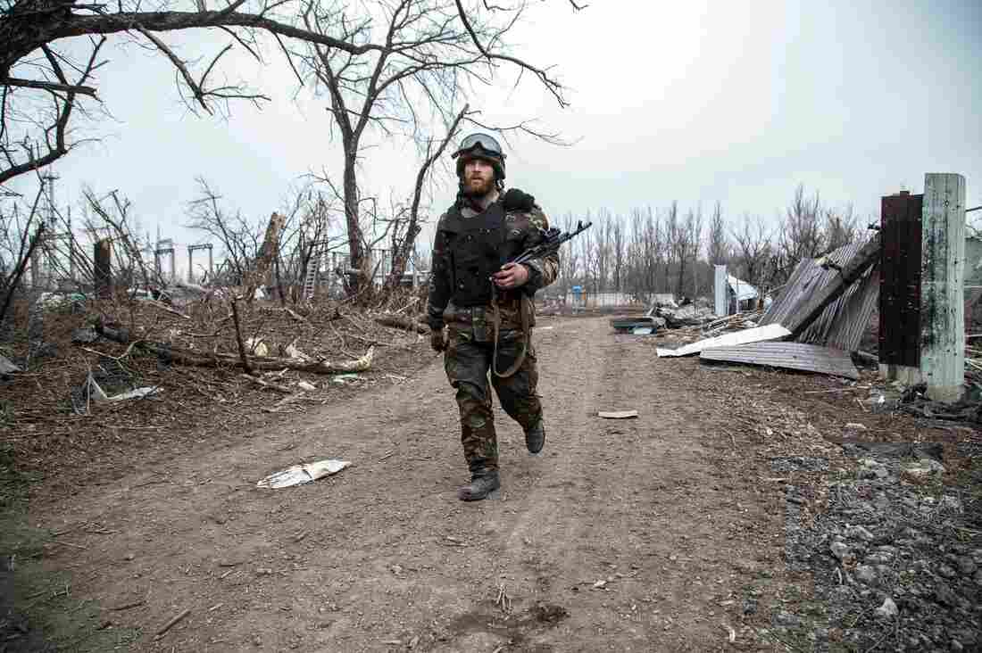 A Ukrainian serviceman walks in the village of Pisky in the region of Donetsk controlled by Ukrainian forces on Feb. 26.