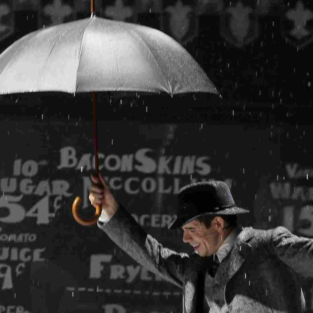 An actor performs during a March 9 rehearsal of Singin' in the Rain on the stage of the Theatre du Chatelet in Paris. American musicals were rarely performed in France in the past, but have been a huge hit in recent years.