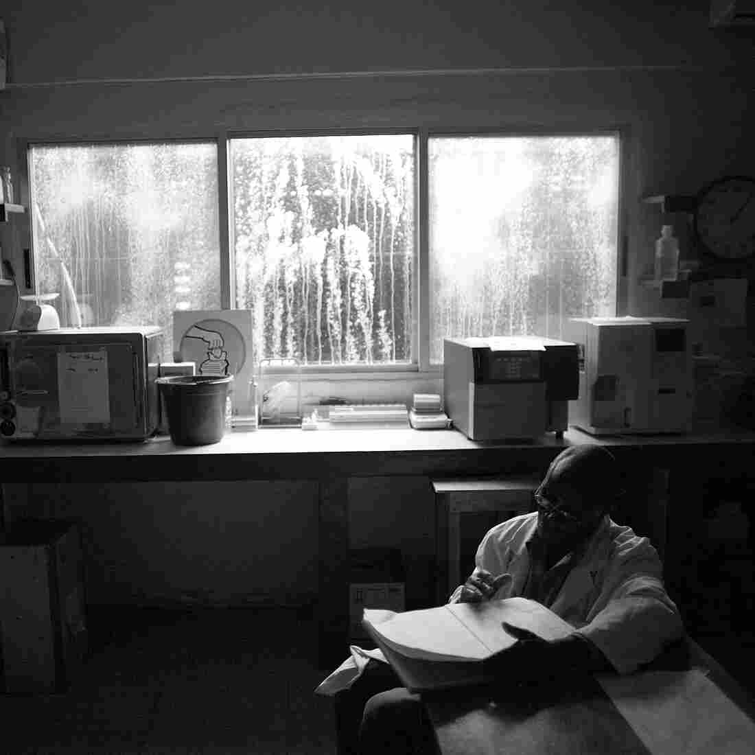 Light shines through the chlorine-stained windows in the blood-testing area at Redemption Hospital in New Kru Town, Monrovia, Liberia.