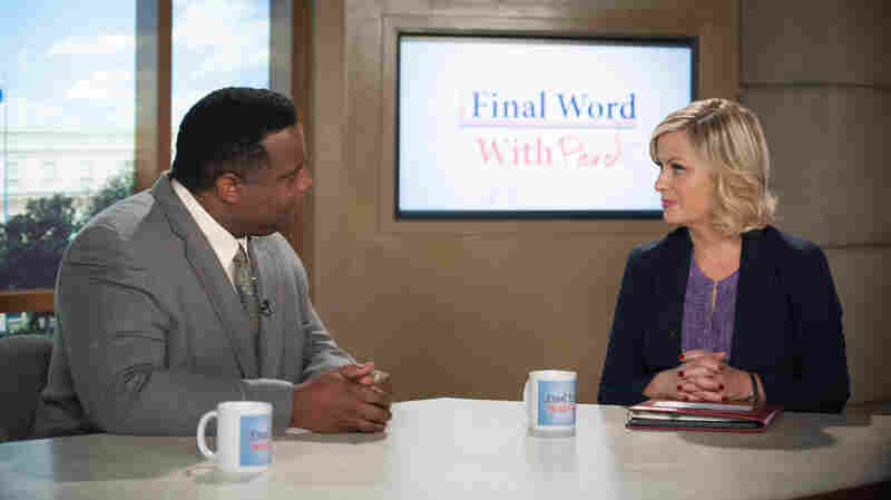 Jay Jackson, as Perd Hapley, interviews Amy Poehler's character Leslie Knope during the sixth season of Parks and Recreation.