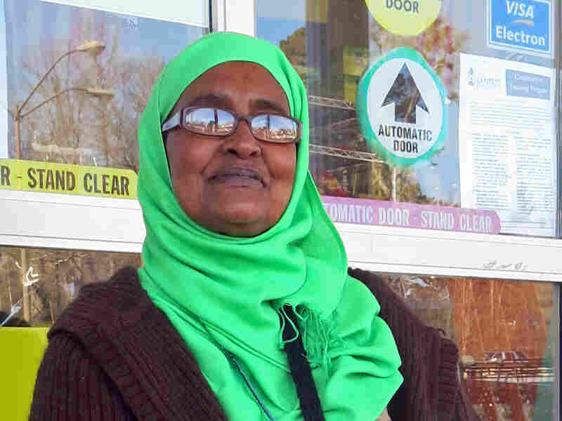 "Amina Osman, known as ""Mama Amina,"" regularly sits outside a Clarkston grocery store, offering help to new refugees."