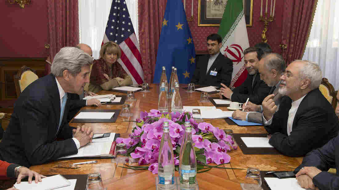U.S. Secretary of State John Kerry (left) and Iranian Foreign Minister Mohammad Javad Zarif (right) at a meeting Wednesday in Lausanne, Switzerland.