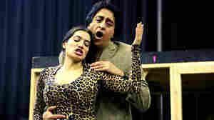 Soprano Catalina Cuervo, singing the role of Frida Kahlo, rehearses with bass baritone Ricardo Herrera, singing the role of Diego Rivera, on Feb. 21, 2015 at the Michigan Opera Theatre in Detroit.