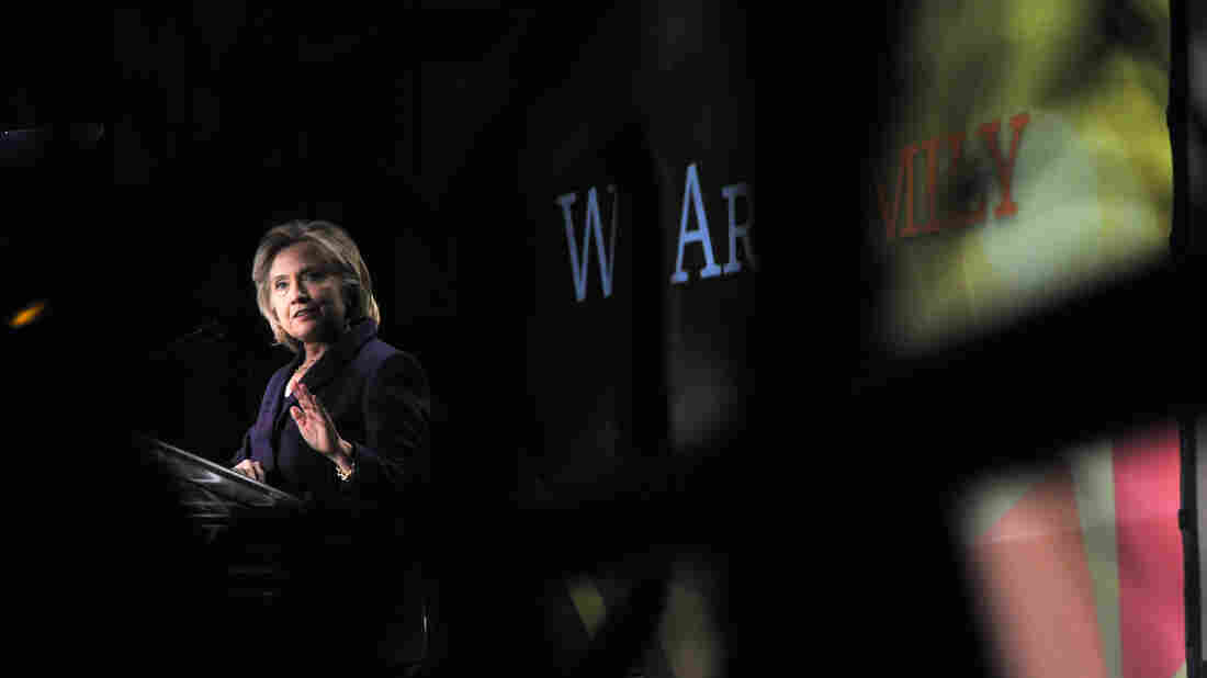 """The complete text on the screen behind the Hillary Clinton read """"We Are Emily."""""""