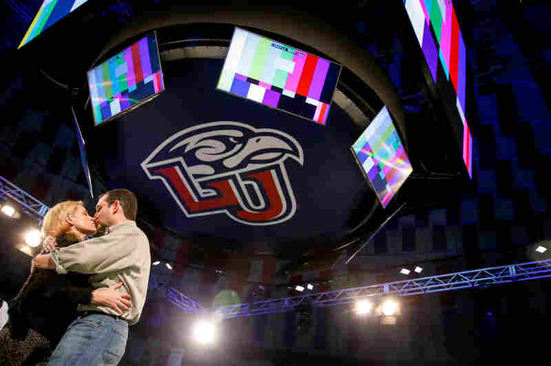 Sen. Ted Cruz kisses his wife, Heidi, during a walk-through Sunday night at Liberty University. Cruz plans to announce his presidential campaign at the school Monday.