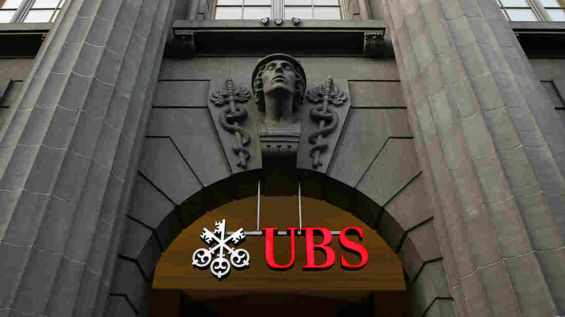 The logo of Swiss bank UBS is seen at the company's headquarters in Zurich. U.S. officials are investigating whether UBS and Barclays manipulated currency rates at a time when they were already operating under a deferred prosecution agreement for manipulating interest rates.