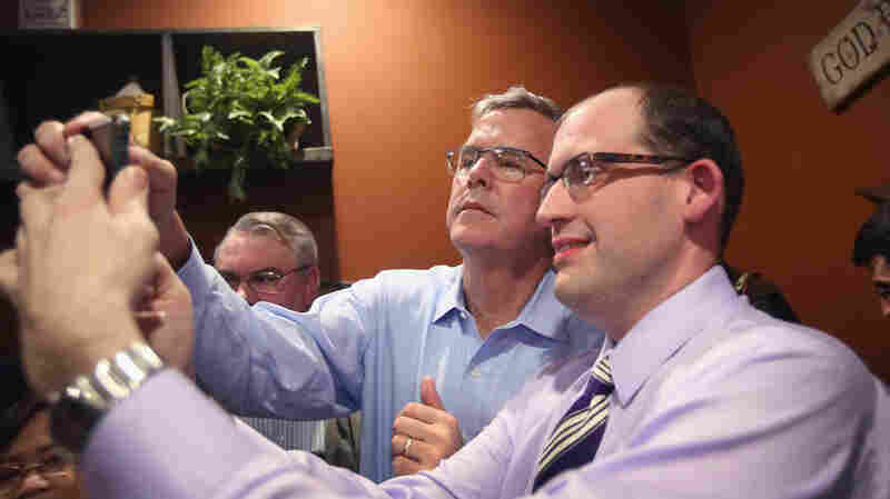 Former Gov. Jeb Bush, a 2016 hopeful, takes a selfie with an Iowa supporter earlier this month.