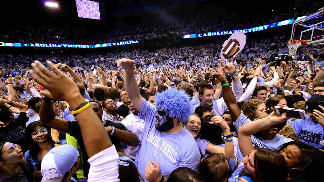 UNC basketball fans storm the court after a win over Duke in 2014.