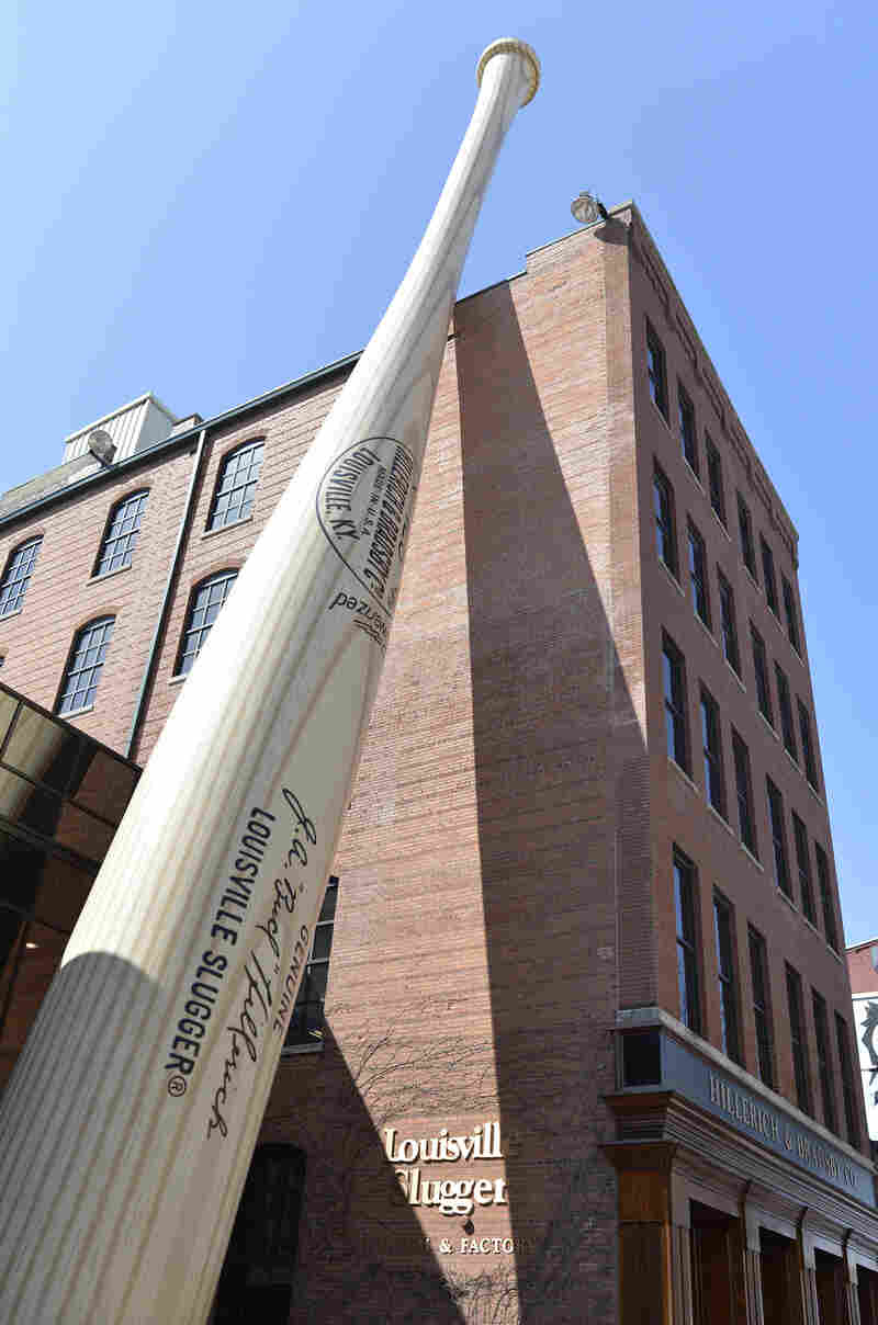 A 120-foot-tall replica bat fronts the Louisville Slugger Museum and Factory in Louisville, Ky. Hillerich and Bradsby on Monday announced a deal to sell its Louisville Slugger brand to Wilson Sporting Goods Co. for $70 million.