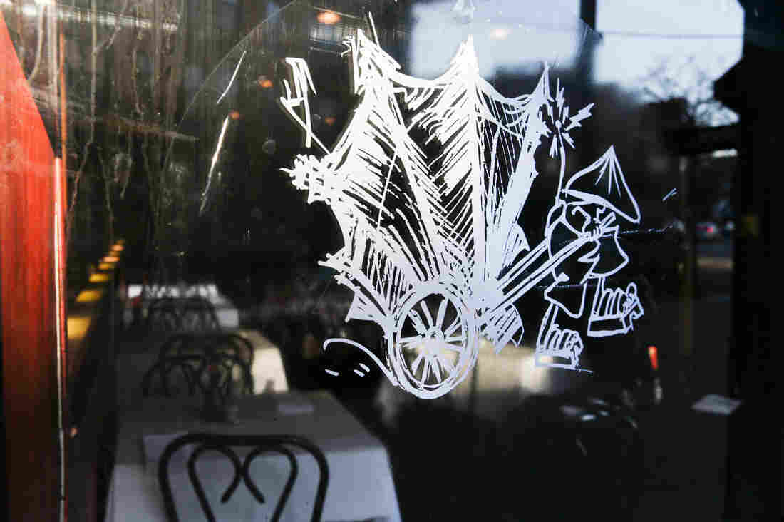 The logo of Chop Chop Chinaman restaurant sits on a window outside the dining area Thursday in Chicago.