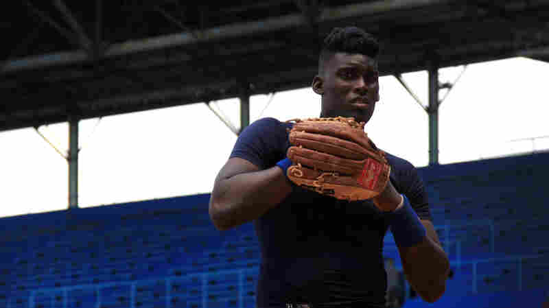 Yoan Francisco, a rookie for the Havana Industriales, warms up before a game at Havana's Latin American Stadium. Cuban baseball has been facing hard times, but improved diplomatic relations with the U.S. have raised the possibility of increased cooperation and new opportunities.
