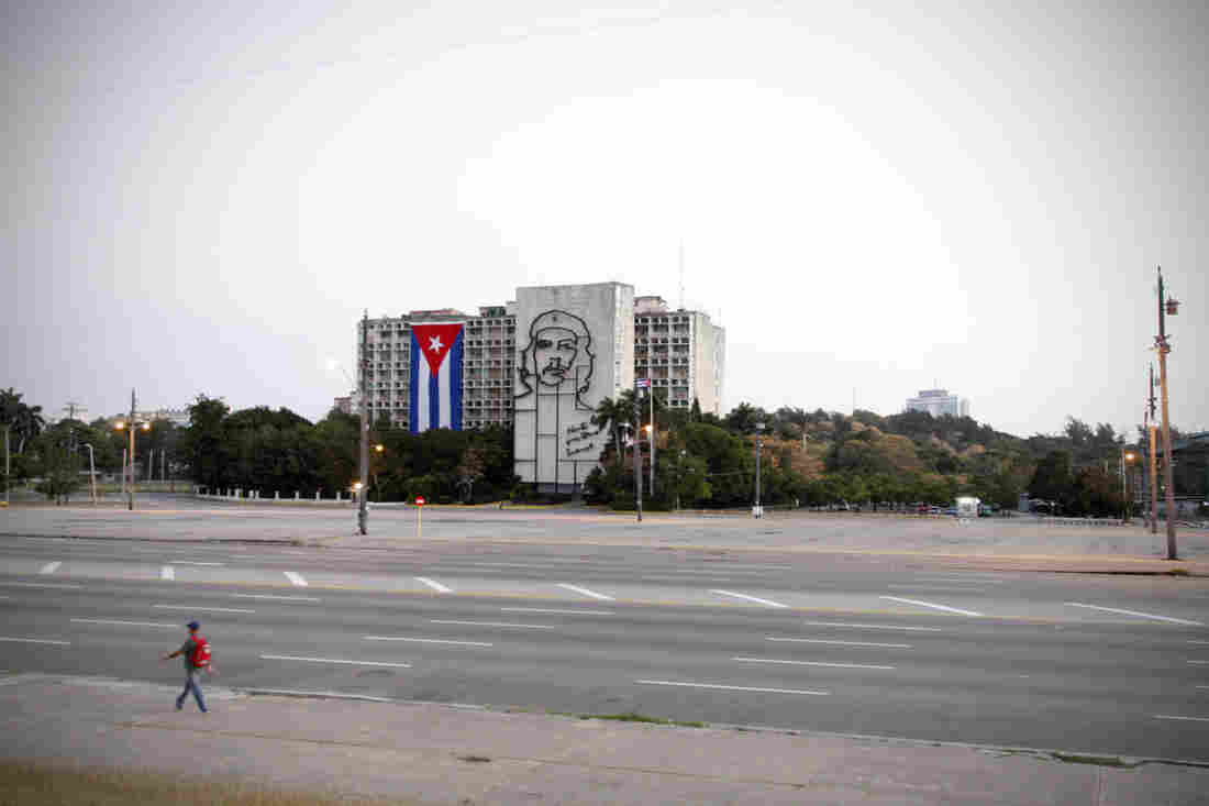 """A image of Ernesto """"Che"""" Guevara overlooks the plaza. The building houses Cuba's Ministry of the Interior."""