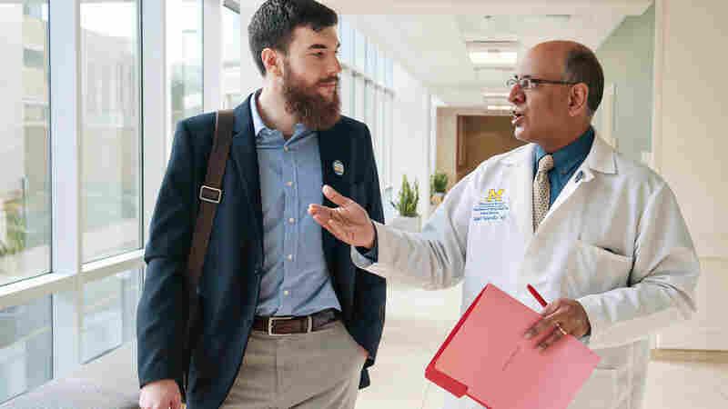 Dr. Raj Mangrulkar and medical student Jesse Burk-Rafel at the University of Michigan Medical School. Good communication skills, teamwork and adaptability will help doctors thrive through swift changes in medical science, Mangrulkar says.
